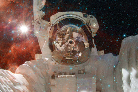 Astronaut. Nebula, cluster of stars. Elements of this image furnished