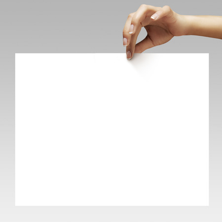 woman hands with ideal manicure holding the white sheet of paper