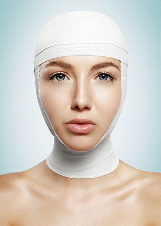 woman after plastic surgery with tied head
