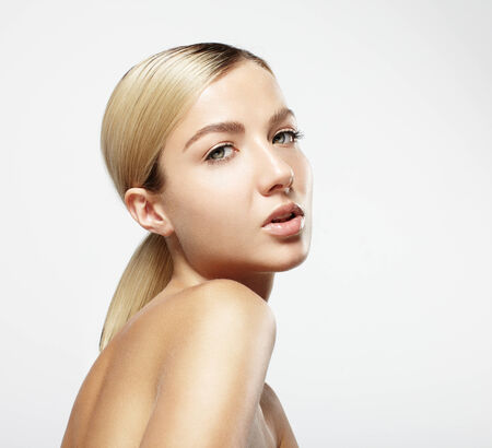 pretty blond girl looking at camera. Ideal skin Stock Photo