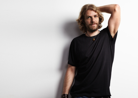 bearded man in a black t-shirt