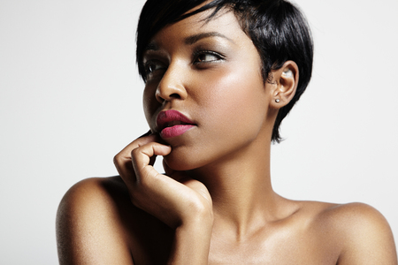 african lady: woman with a short haircut and black skin Stock Photo