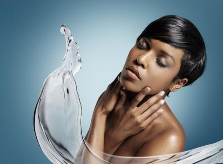 concept of a skin moistening with an aqua splash photo