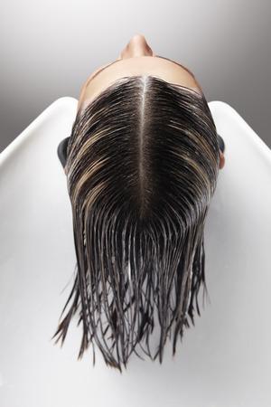 hair treatment: long hair treatment in salon Stock Photo