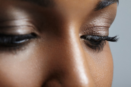 closeup image of black womans eyes with nude makeup