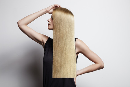 blond woman showing ideal hair