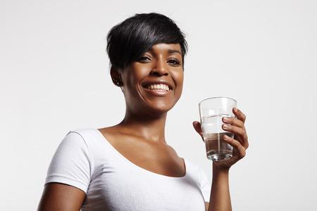 Vrouw drinkt water Stockfoto - 34638492