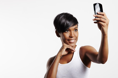 black woman making selfie with mobile