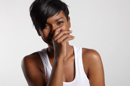armpit hair: laughing black woman Stock Photo