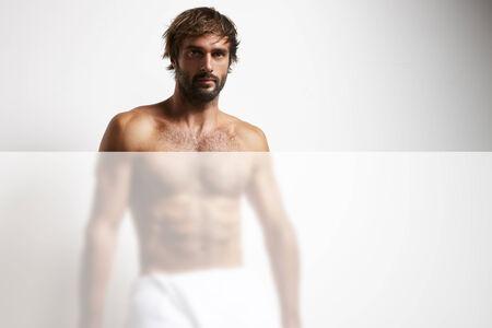 man in the towel behind the matt glass photo