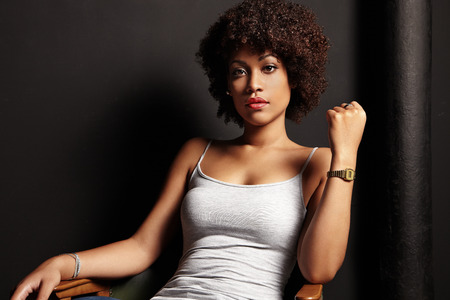 african lady: pretty black woman on a chair Stock Photo