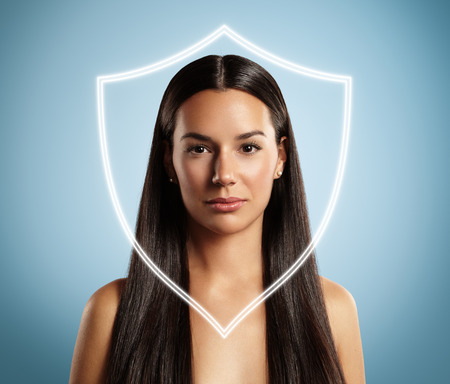 skin protection: woman behind the shield. Concept of a skin protecrion