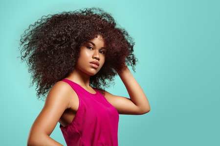 colorful portrait of a black woman with volume curly hair Stock Photo