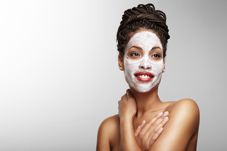 black womn with a facial mask Stock Photo
