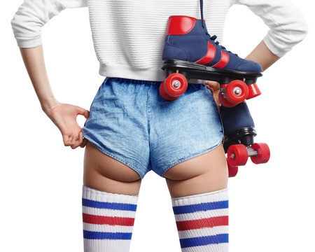 ass fun: woman with roller skates on her shoulder shift her shorts