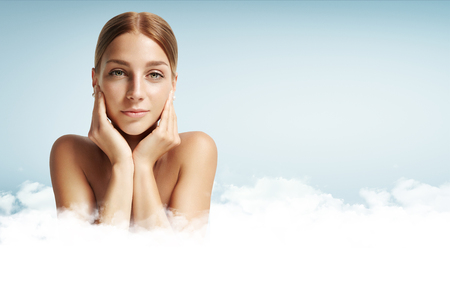 ideal: woman with ideal skin in a clouds