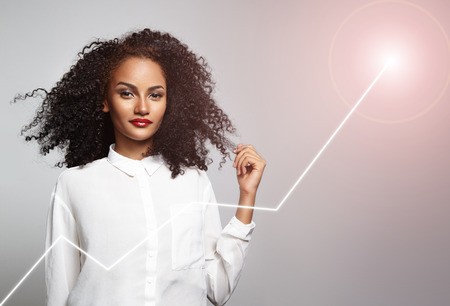 curly hair woman: success of businesswoman Stock Photo