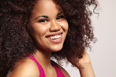 black women hair: happy woman with big afro hair Stock Photo