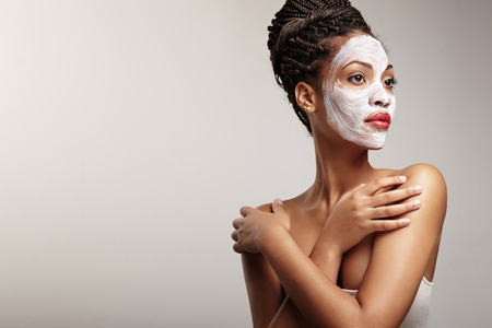 clay: woman in process of a facial treatment Stock Photo