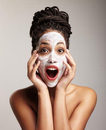 black woman have fun with a facial treatment Archivio Fotografico