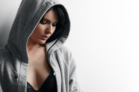 earing: woman earing hoodie. closeup portrait