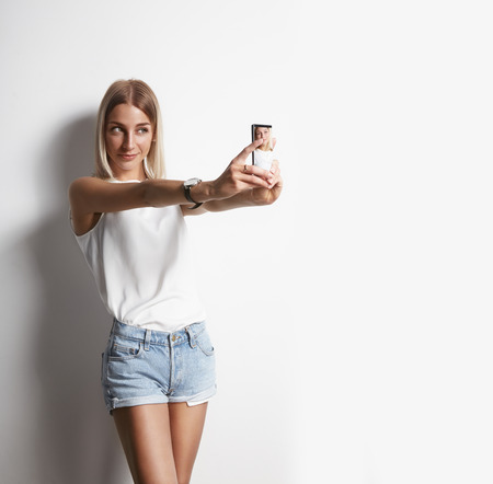 girl making selfie with a mobile phone