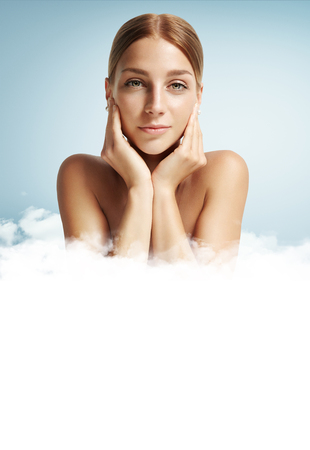 woman surrounded with a clouds Stock Photo