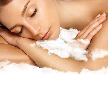 sleep well: beauty woman with ideal skin sleaping on a cloud