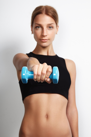 woman holding barbell towards the camera Stock Photo