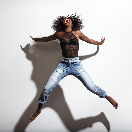 black woman shout and jumping