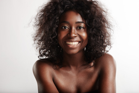 afro curly hair: beauty black woman with a perfect smile