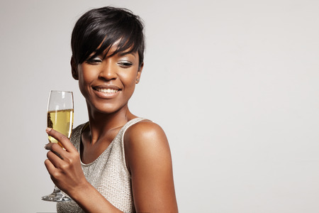 woman with a short haircut holding champagne