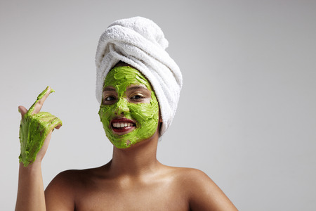 black woman have fun with an avocado mask