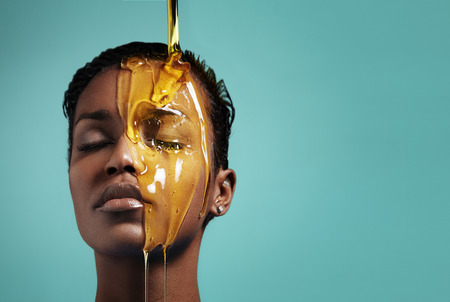 exfoliate: woman with a honey on her face