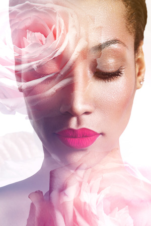 multiple exposure: double exposed closeup portrait of a woman with a roses Stock Photo