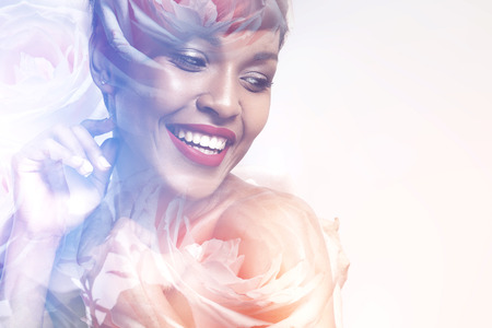 multiple exposure: Double exposure of happy smiling woman and roses Stock Photo