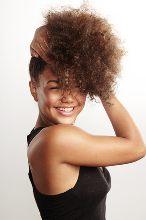 young style: girls have fun with her afro hair Stock Photo