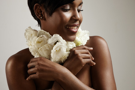 outumn: woman with a flower neckless. Perfume concept