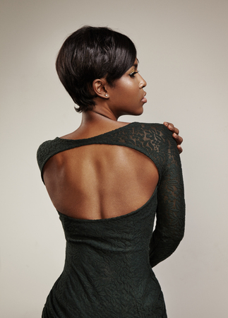 woman's back wearing green evening dress. Open back.
