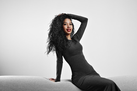 latin look: perfect fit black woman with a curly hair and red lips Stock Photo