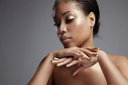 outumn: closeup womans face with a golden makeup Stock Photo