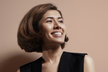 happy shiny asian woman with a short hair