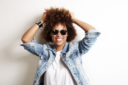 latin american: pretty african woman have fun with her curly hair