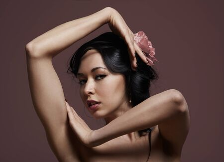 atractive: portrait of a beauty asian woman with a flower on hair Stock Photo