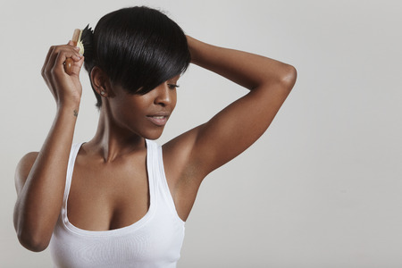 combing: pretty black woman is combing Stock Photo