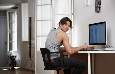 artists mannequin: man working in his apartment, looking back Stock Photo