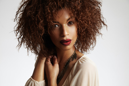 beauty black woman with a curly hair and red lips