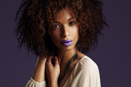 black woman with a bright metall matte violet lips