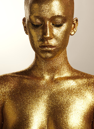beaity woman with golden skin Stockfoto