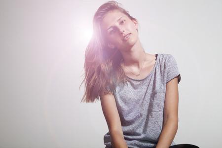 prety: prety girl wearing grey casual t-shirt, smiling, brackets. Stock Photo